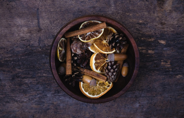 Tangerines, cones, spices on a wooden background. ãâ¡oncept of new year and christmas, christmas drink mulled wine. flat lay, top view. banner