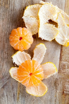 Tangerines lying on the  board