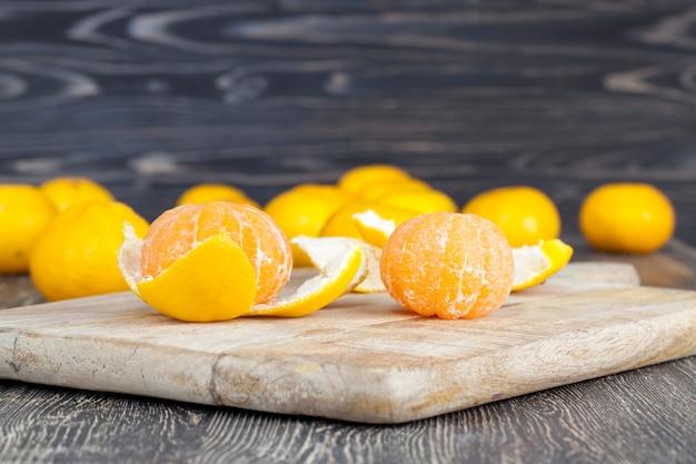 Tangerines lying on the cutting board