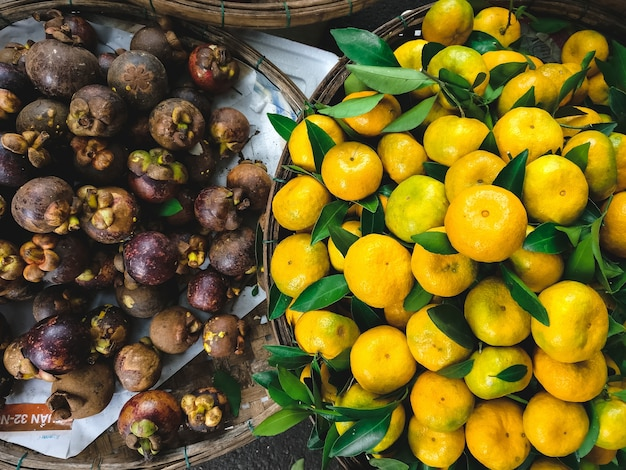 Tangerines and mangosteen at market