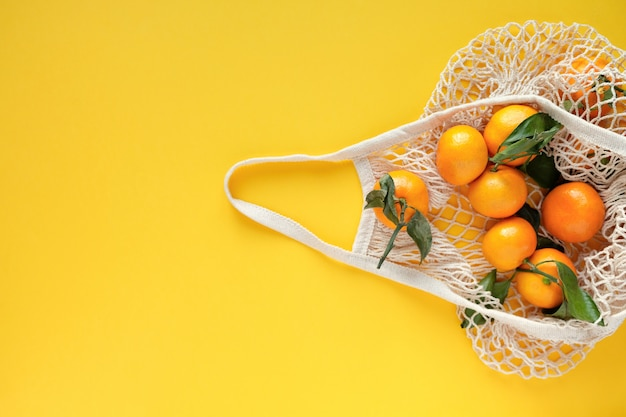 Tangerines in a string bag