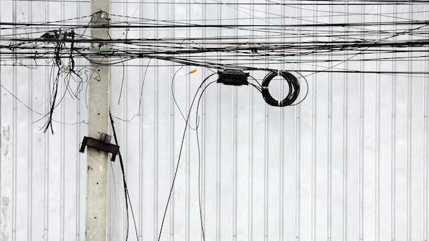 Tangle electric line on pole at the street in the city