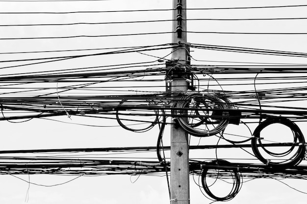 Tangle electric line on pole