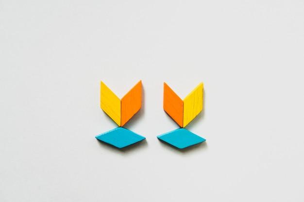 교육 및 창조적 인 개념을위한 tangram 퍼즐 트리 모양 사용