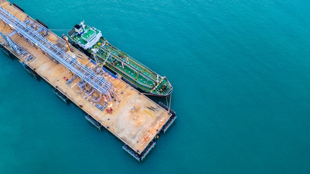 Tanker ship loading in port view from above, tanker ship logistic import export business