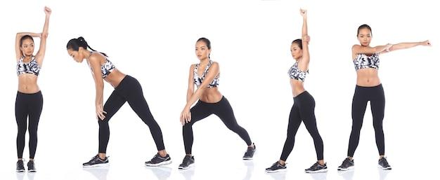 日焼けした肌アジアの女性はフィットネススポーツブラヨガパンツスニーカーを着用します。完全な長さの女性の運動と白い背景の上の健康的な汗が分離されました
