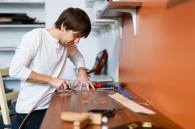 Tanner in workshop
