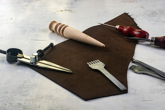 Tanners tools with brown leather piece