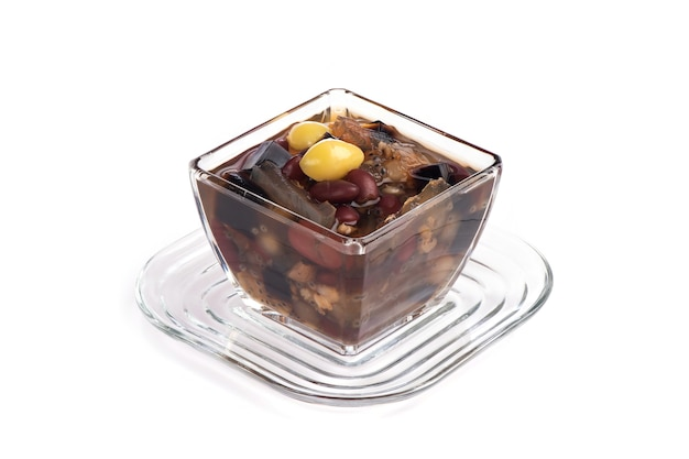 Tao tueng, a dessert contains red beans, soybeans, mung beans, millet, jujube, ginkgo isolated on white background.