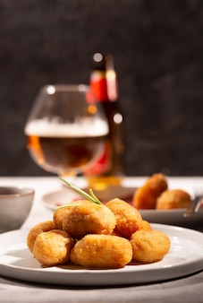 Tapas croquettes, traditional spanish or french snack with beer