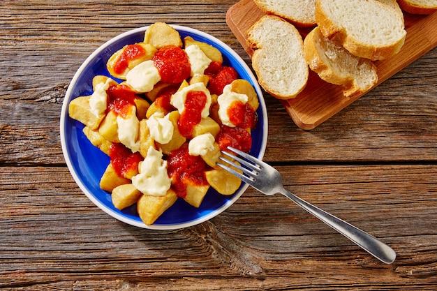 Tapas patatas bravas potatoe fries with tomato