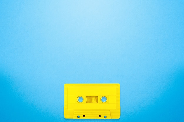 Tape cassette yellow color places on blue background
