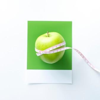 Tape measure around an apple