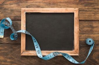 Tape measure on chalkboard