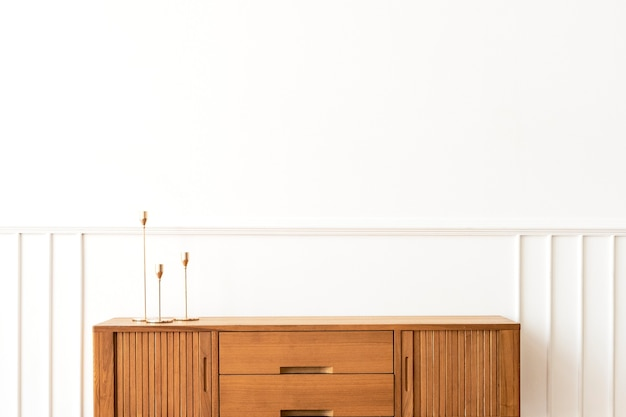 Taper candle holders on a wooden sideboard table