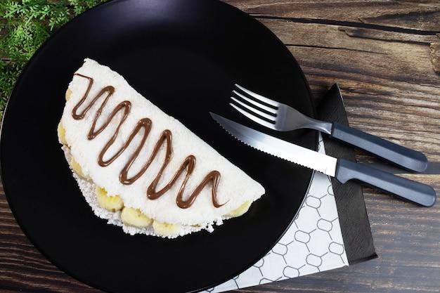 Tapioca typical of northeastern brazil banana with chocolate and hazelnut cream