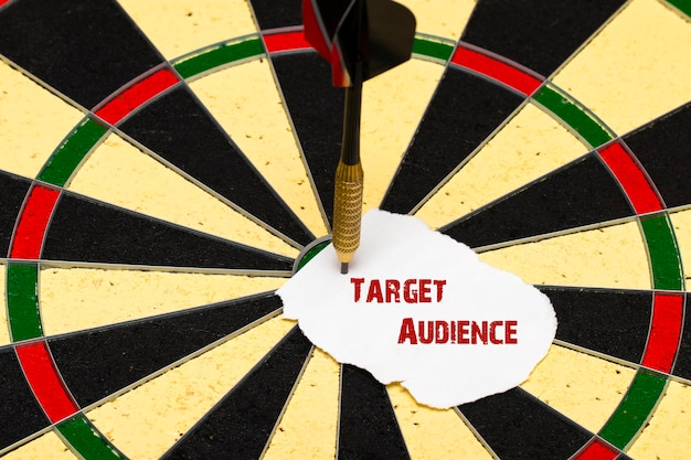 Target audience. darts with dart arrow which was pinned a sheet of paper for labels