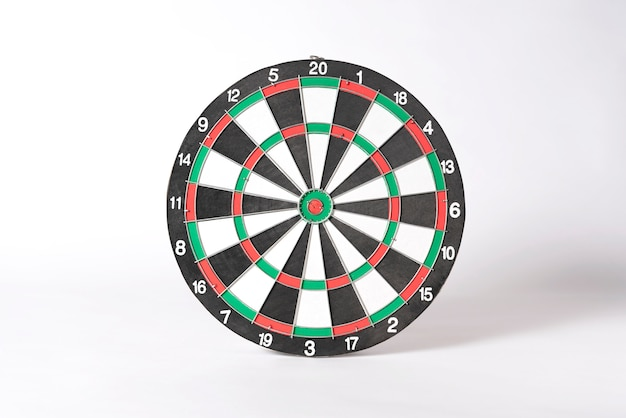 Target dart board on gray background.