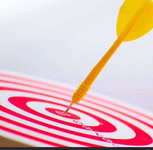 Target dart pin on center 10 point dartboard  marketing concept.