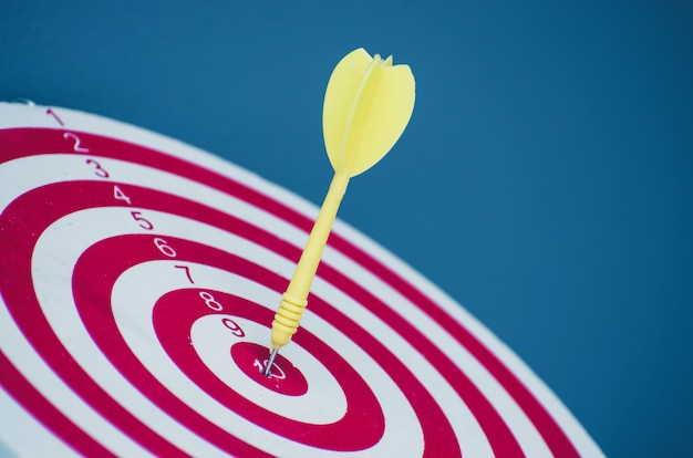 Target dart pin on center 10 point dartboard marketing concept.