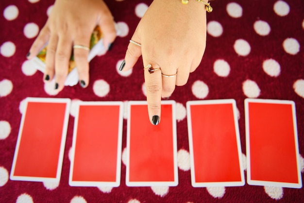 Tarot cards reading divination psychic readings and clairvoyance fortune teller hands