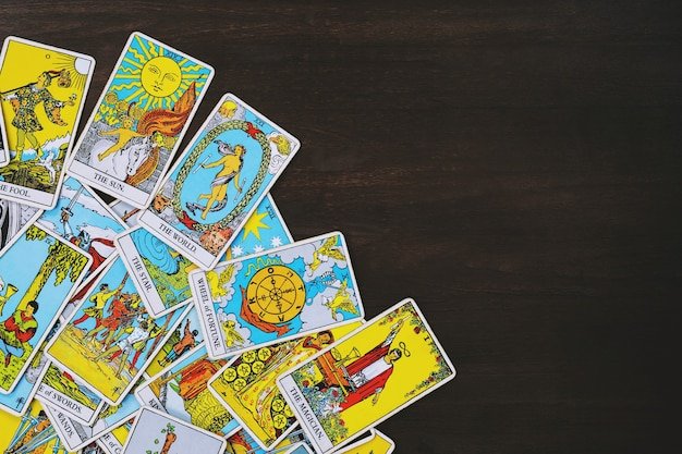 Tarot cards on wooden table