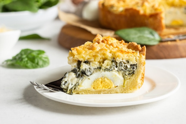 Tart or pie with spinach, ricotta and eggs. torta pascualina.