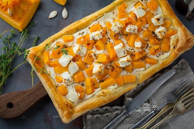 Tart with pumpkin, feta, ricotta cheese and thyme