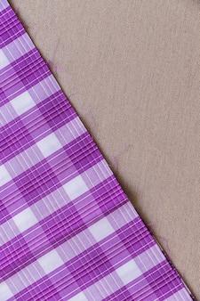 Tartan plaid fabric on plain textile