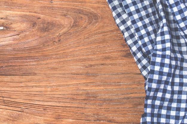 Tartan, wooden background