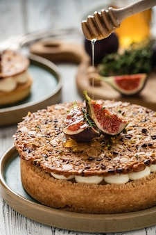 Tarte on sand base with fresh figs, almonds and crispy waffle with almonds and cocoa powder. fresh homemade fruit tart with berries