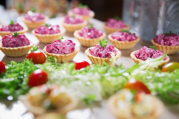 Tartlets with beetroot salad on buffet table