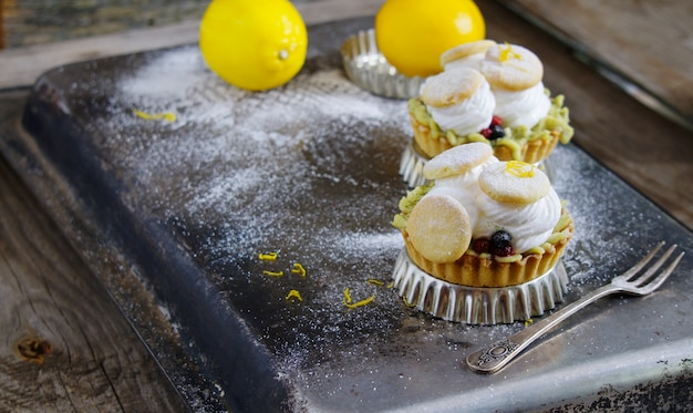 Tartlets with cream, tea matcha curd and whisked egg whites