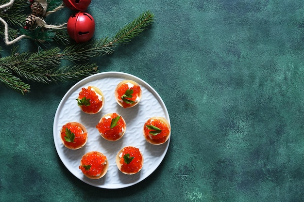 Tartlets with red caviar on the new year's table.