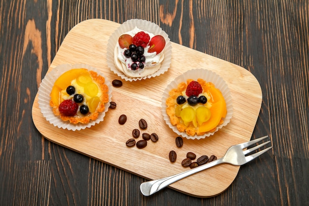 Tartlets with sweet cream and fresh berries juicy