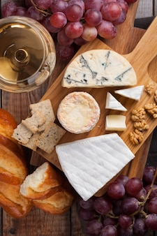 Tasting cheese dish on a wooden background.