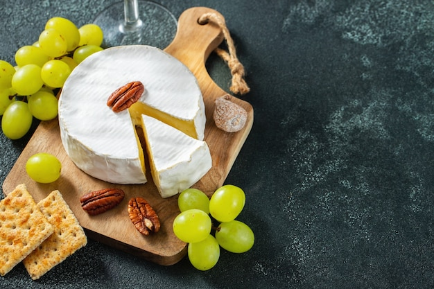 Tasting cheese dish on a wooden plate.