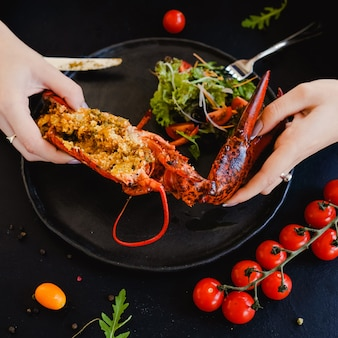 Tasting restaurant stuffed lobster dish concept. lifestyle of high society. delicious and expensive food. proper nutrition.