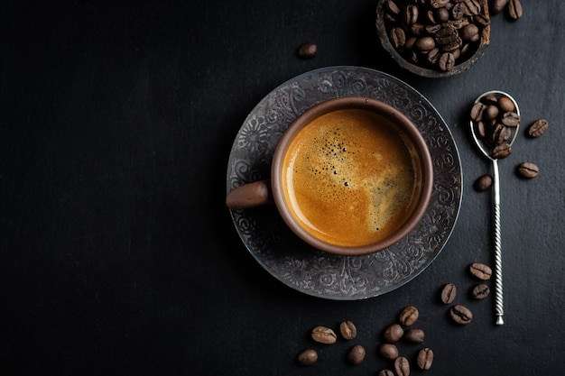 Tasty americano coffee in cup with coffee beans