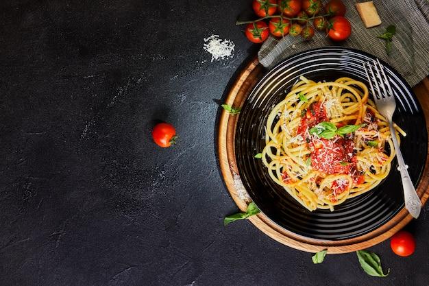 Tasty appetizing classic italian spaghetti with tomato sauce