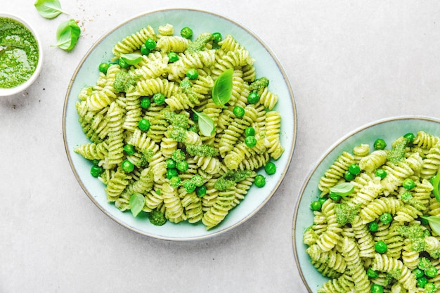Tasty appetizing pasta with pesto on plate