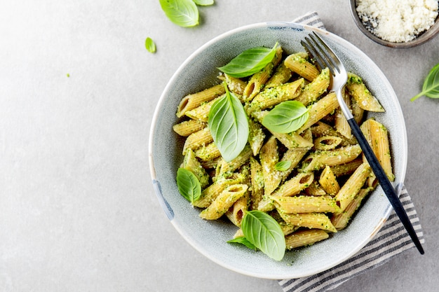Tasty appetizing pasta with pesto sauce