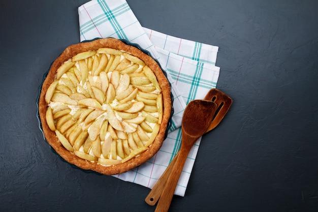 Tasty apple pie on dish copy space.