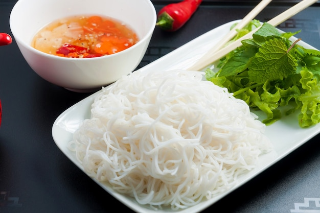 Tasty asian cuisine rice noodles with sauce close up