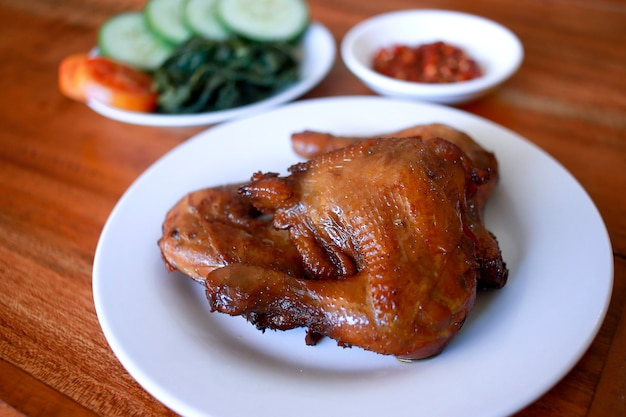 Tasty ayam bakar madu with sambal, traditional barbeque chicken from indonesia