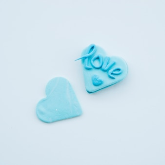 Tasty azure cookies in form of hearts