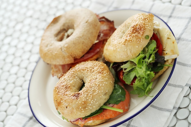 Tasty bagel sandwich with bacon