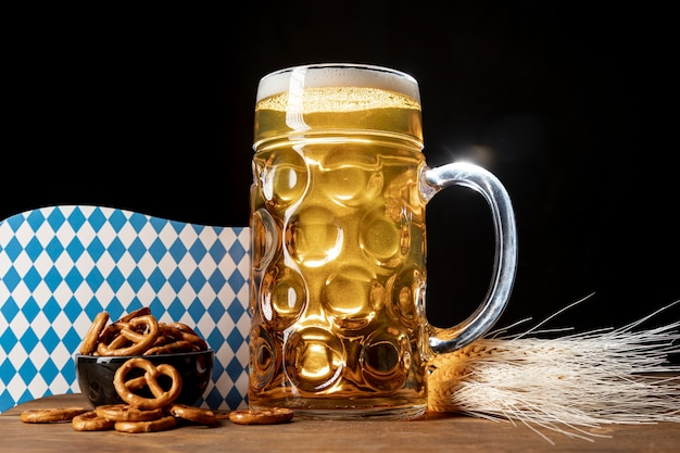 Tasty bavarian beer on a table with pretzels