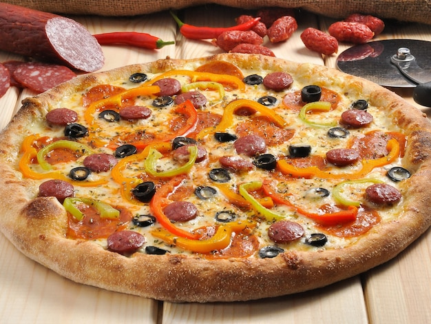 Tasty bavarian pizza with sausages bell peppers and olives