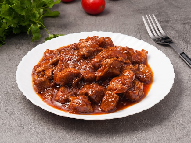 Tasty beef goulashstewed beef with onions tomato paste and spices